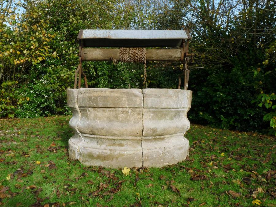 Antique stone chateau well-head