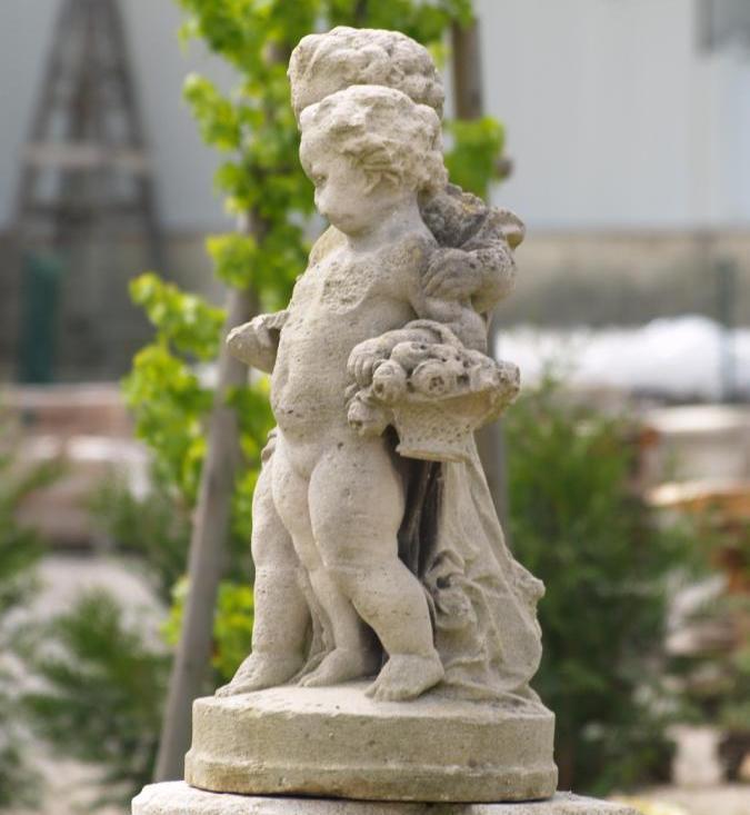 Antique stone statue of cherubs
