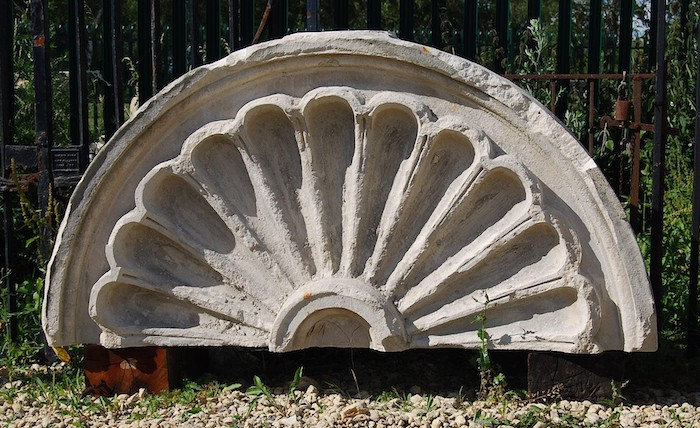 An English Portland stone demi-lune pediment